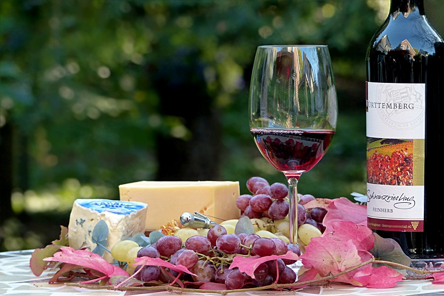 Tips For Cooking With Wine Sitting on a Cutting Board with Cheese