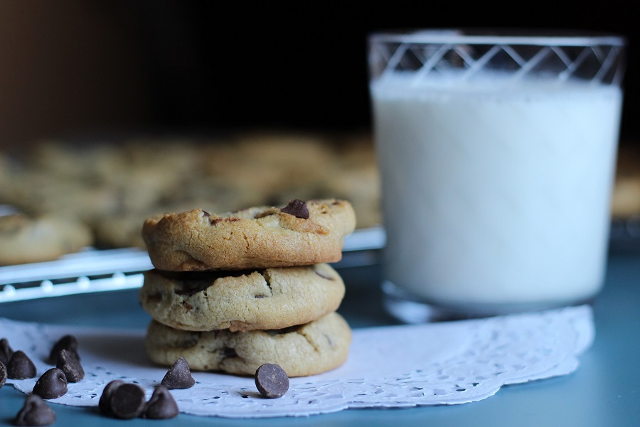 Best Chocolate Chip Cookie Recipes a Stack of Cookies Next to a Glass of Milk