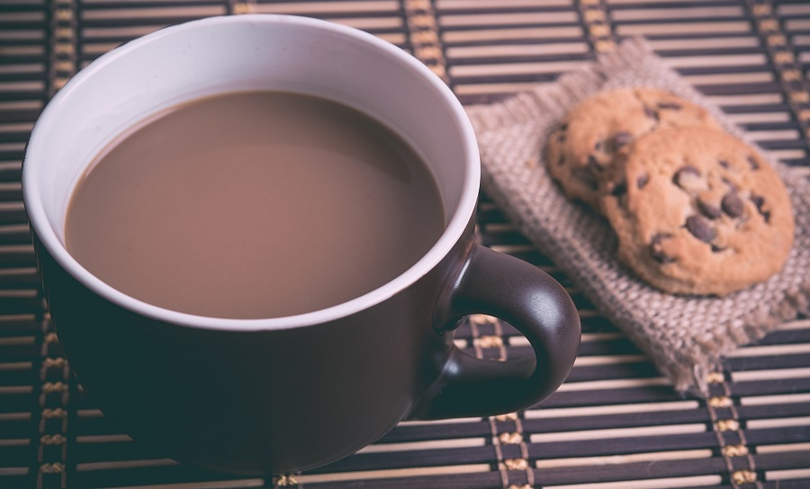 Best Chocolate Chip Cookie Recipes a Cup of Hot Chocolate with Cookies Next to it