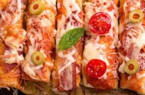 You don't have to be a football person to love the best pizza recipes! Complete your football party with these easy pizza recipes or try some custom pizza recipes that you can make yourself right at home.