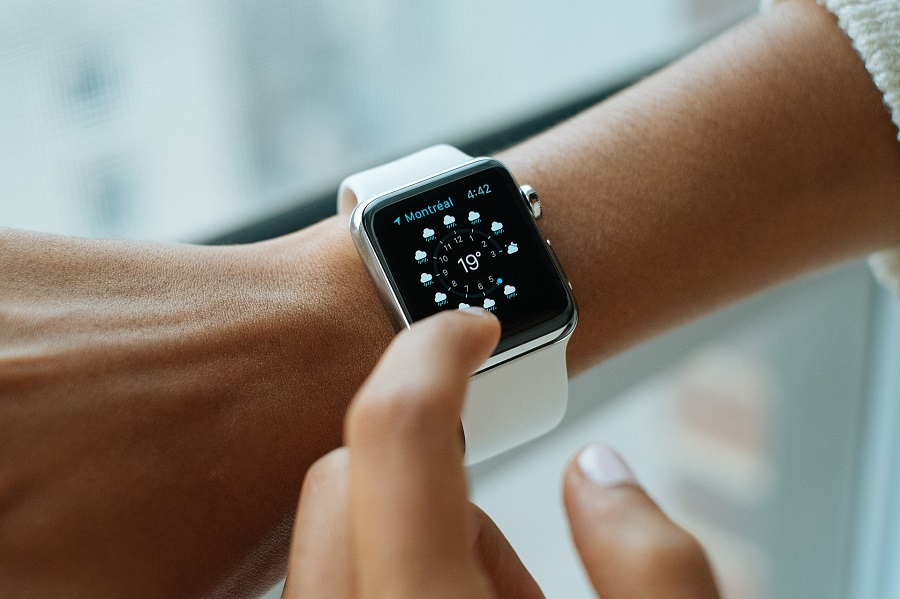 Best Time Management Tips Person Looking at a Smartwatch