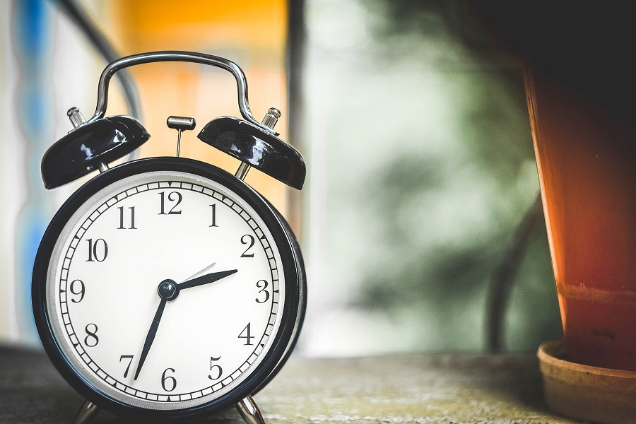 Best Time Management Tips Classic Alarm Clock on a Table