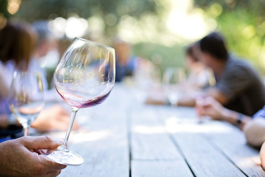 Wine Etiquette Tips Person Holding a Wine Glass