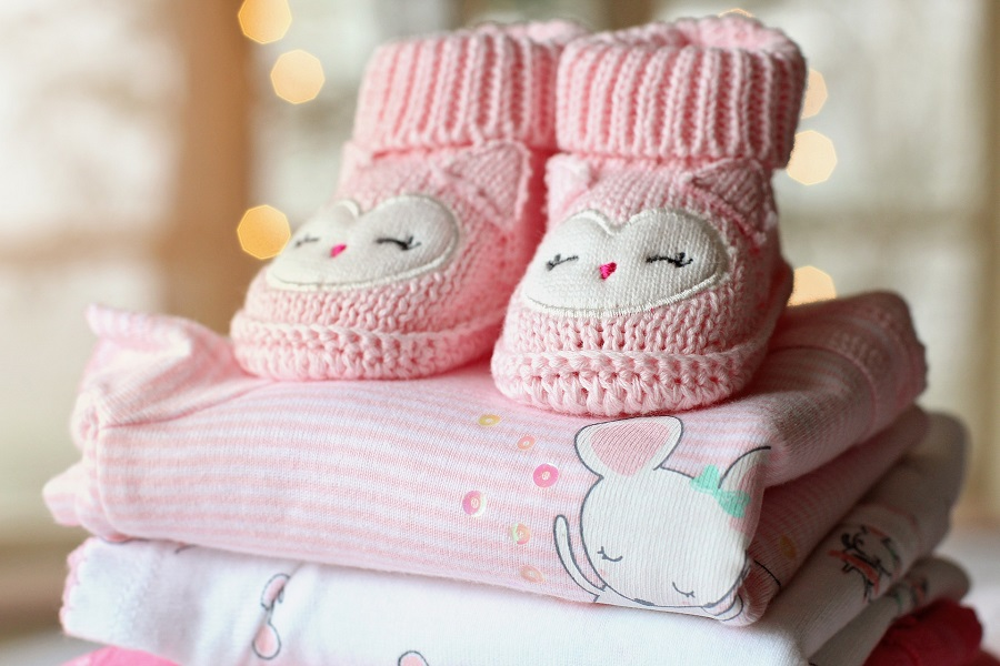 Baby Shower Ideas for Girls Close Up of Clothing Folded and Stacked for a Baby Girl
