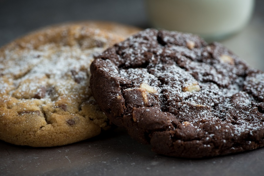 Gluten Free Chocolate Chip Cookies Recipes One Chocolate Chip Cookie Next to a Chocolate Chocolate Chip Cookie Sprinkled with Powdered Sugar
