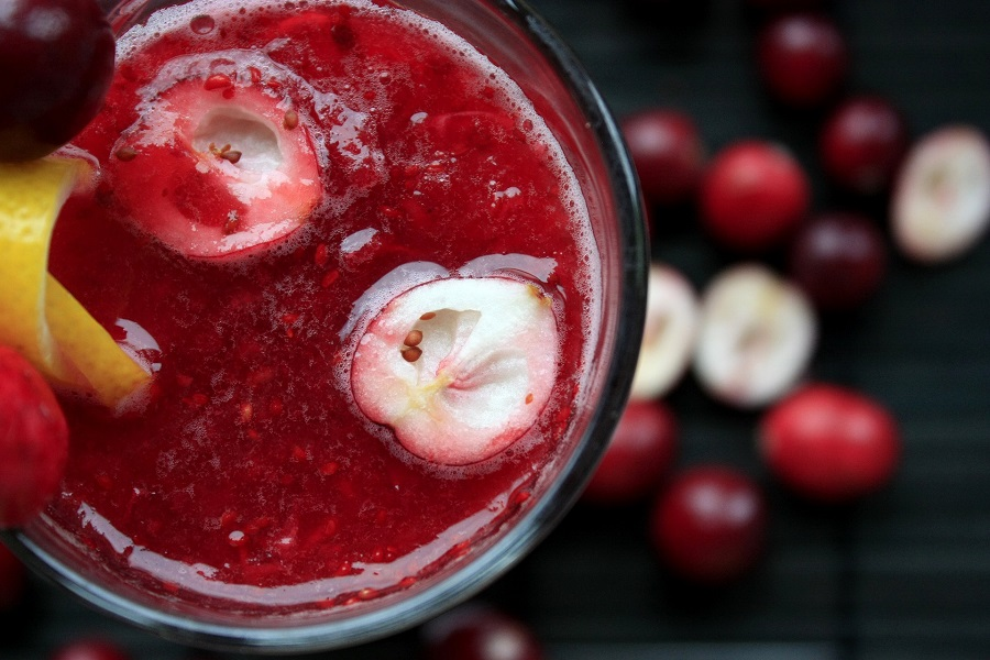 Overhead View of a Cranberry Smoothie with Cranberries Surrounding the Glass