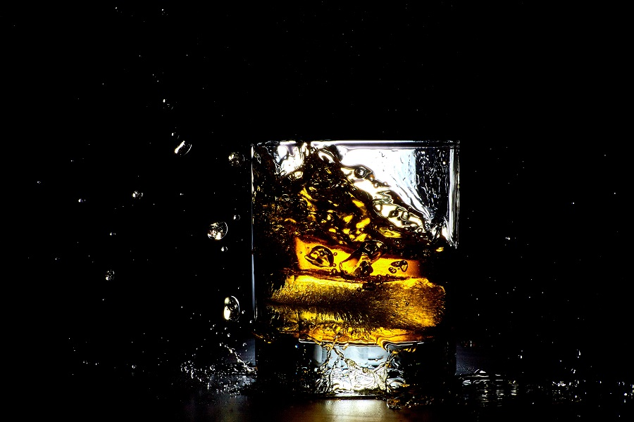 Whiskey Drinks for Summer Whiskey Splashing into a Glass