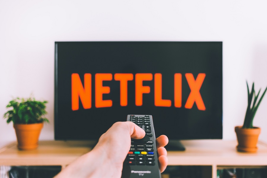 Best Netflix Series for Teens remote pointing at the tv