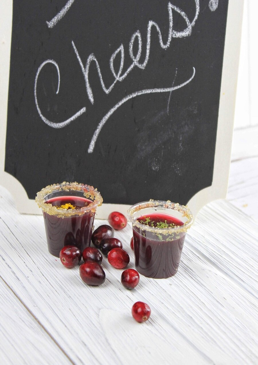 These cranberry jello shots are tart, sweet and will even make your uncle's jokes seem that much funnier at the holiday table. It's a win/win for everyone. Jello Shot Ideas | Vodka Jello Shots | Holiday Recipes | Holiday Recipes Adults | Christmas Cocktails | Christmas Jello Shots | Cranberry Jello Recipe | How to Make Strong Jello Shots
