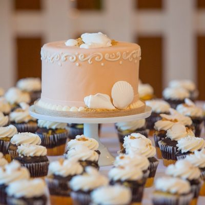 Cupcake cakes for a wedding can be as customized as any of the best wedding cakes can be and they are even easier to share with the entire party. Cupcake Wedding Cake Stand | Wedding Cakes with Cupcakes on Tiers | Wedding Cake with Cupcakes Around It | Cupcake Wedding Dress Cake | Cupcake Wedding Cake Blue