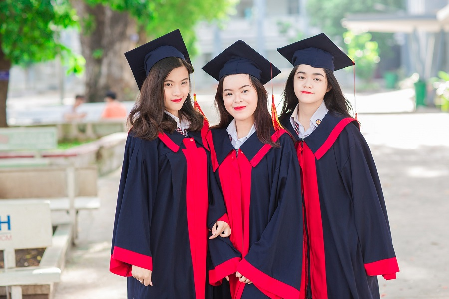 graduation quotes from parents 3 graduate girls in gowns
