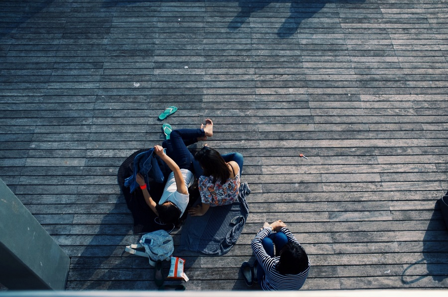 Netflix Series for Teens Overhead View of a Group of Friends Sitting on a Deck