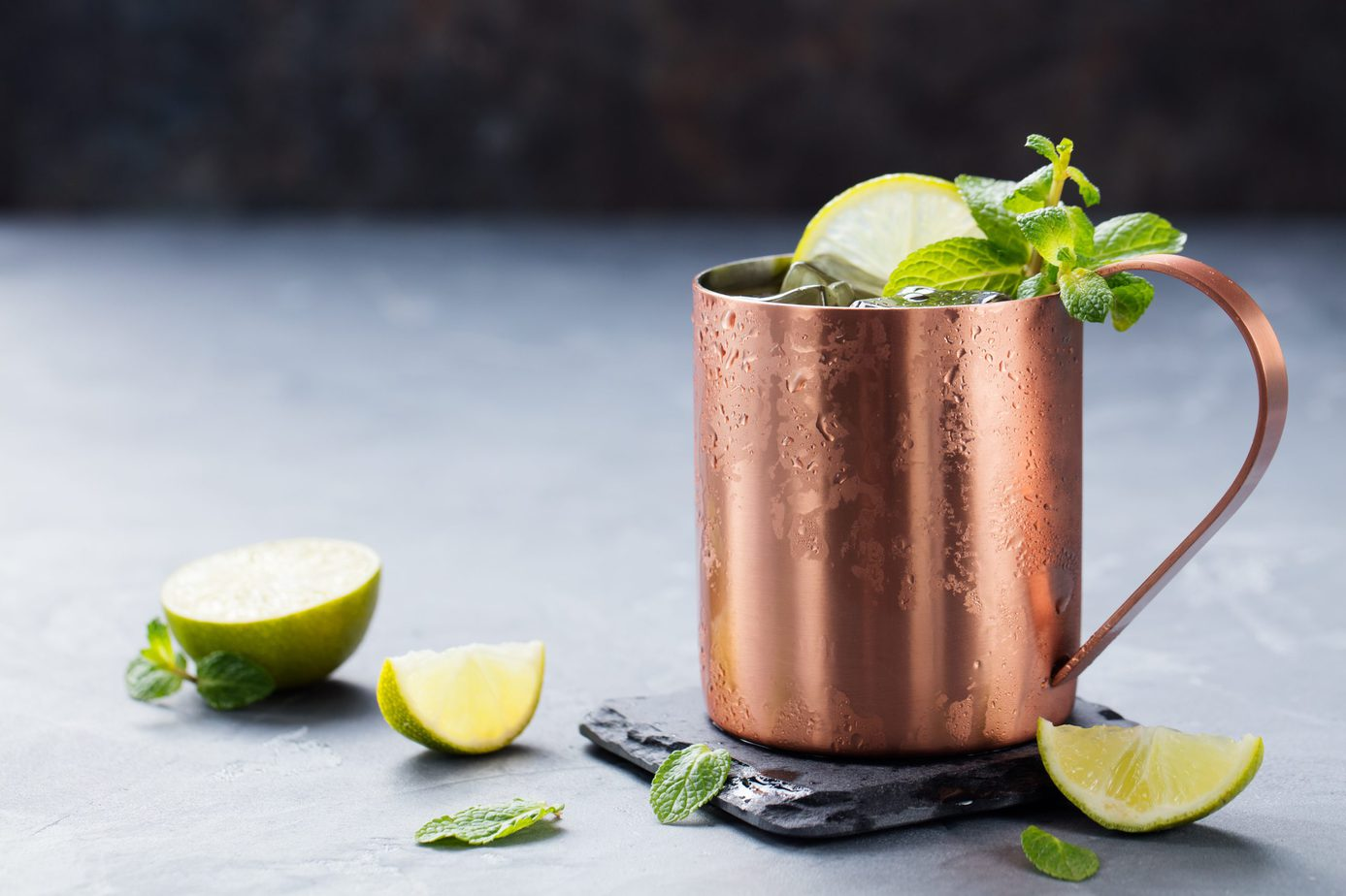 copper cocktail glass with limes