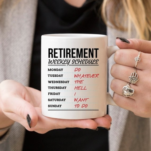 Woman holding retirement weekly schedule coffee mug