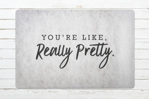 """You might be feeling a little flirty and could use some dating advice. Look no further than the """"You're like really pretty"""" doormat to move the next relationship forward. Flirty Doormat 