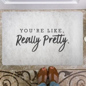 """You might be feeling a little flirty and could use some dating advice. Look no further than the """"You're like really pretty"""" doormat to move the next relationship forward."""