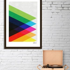 Add a touch of retro style with this colorful triangles framed art print that fits into just about any type of home or apartment decor.