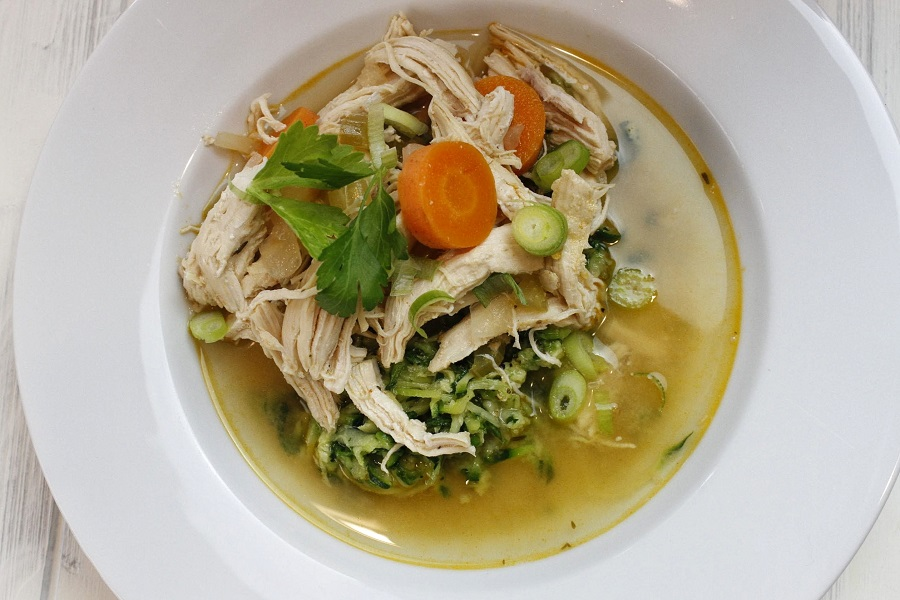 Whole30 Instant Pot Chicken and Vegetable Soup Overhead View of Soup in a White Bowl