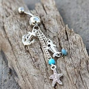 There is no better way to accessorize a bikini at the beach than with a nautical beach charms dangle navel ring. Belly Button Rings for Summer | Summer Belly Button Ring | Navel Ring Online | Dangle Belly Button Rings | Beach Belly Button Rings | Summertime Belly Button Ring | Summertime Jewelry #jewelry #summer