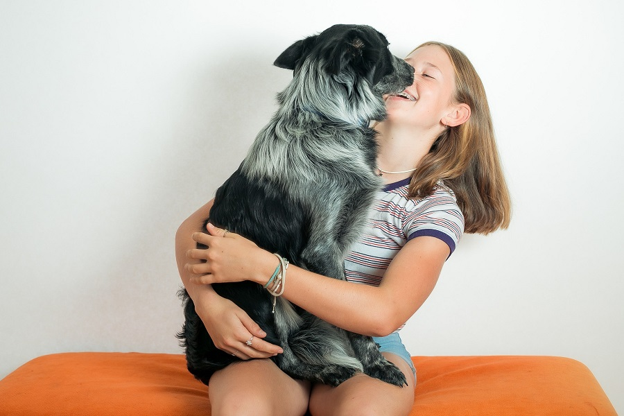 Sweet Dog Quotes About Love Girl Sitting Down with a Dog on Her Lap Licking Her Face
