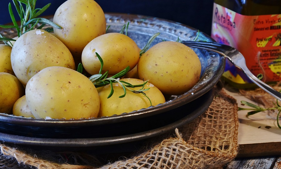 Instant Pot German Potato Salad Recipes Close Up of a Bowl Filled with Potatoes and Herbs
