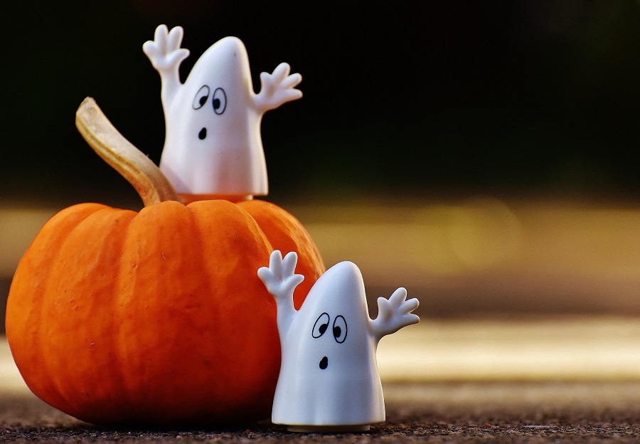 Instant Pot Halloween Recipes Two Small Ghost Figures on a Smaller Pumpkin