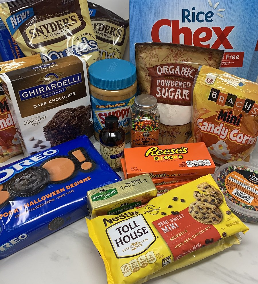 Halloween Puppy Chow Recipe Ingredients on a Counter