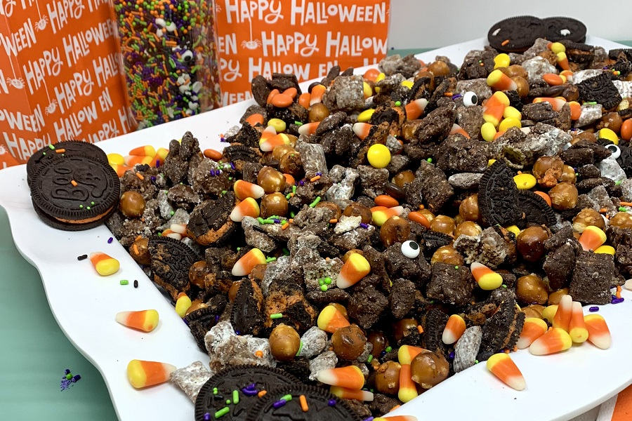 Halloween Puppy Chow Recipe Finished on a Platter with Treat Bags in the Background