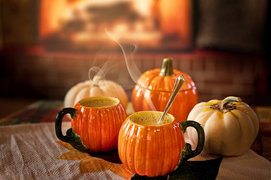 Instant Pot Halloween Recipes Pumpkin Shaped Cups with Steam Coming From Them
