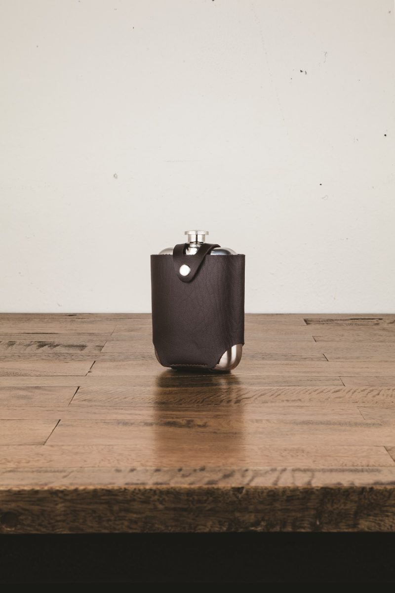 Stainless Steel Flask Sitting on a Desk