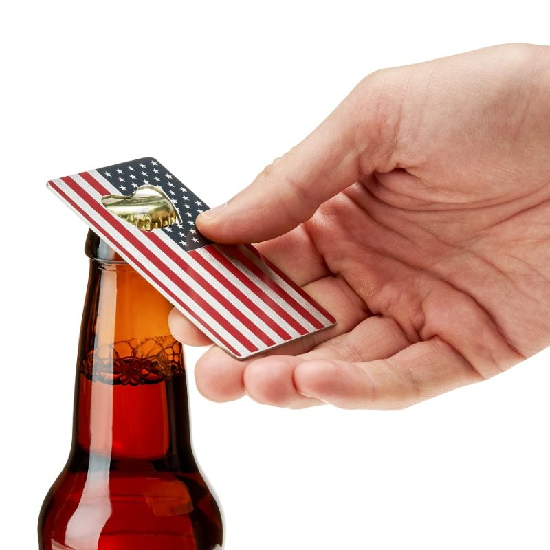 Person Using a USA Flag Bottle Opener on a Bottle