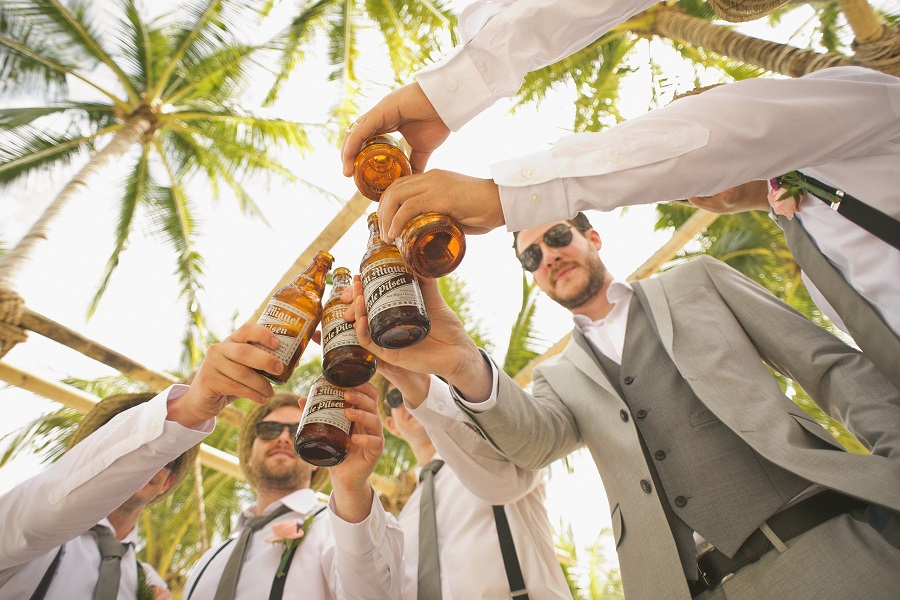 Funny Drinking Toasts A Group of Men at a Wedding Clinking Beers together