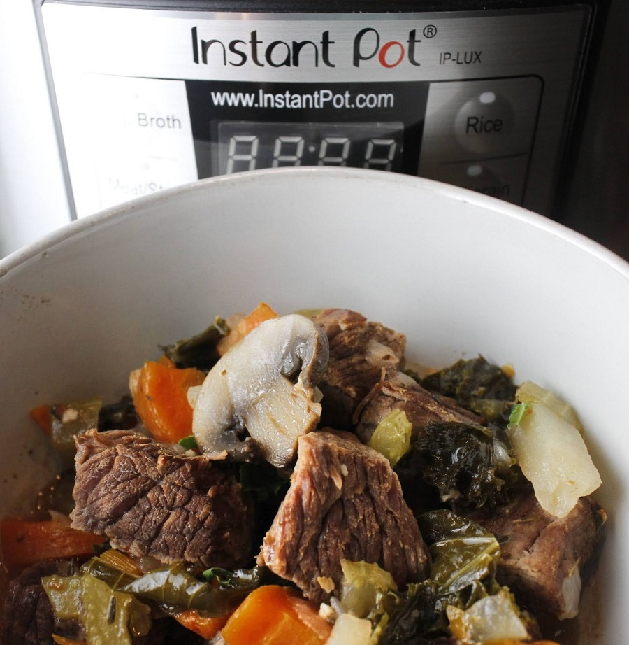 Whole30 Instant Pot Beef Stew Recipe Bowl of Stew Next to Instant Pot