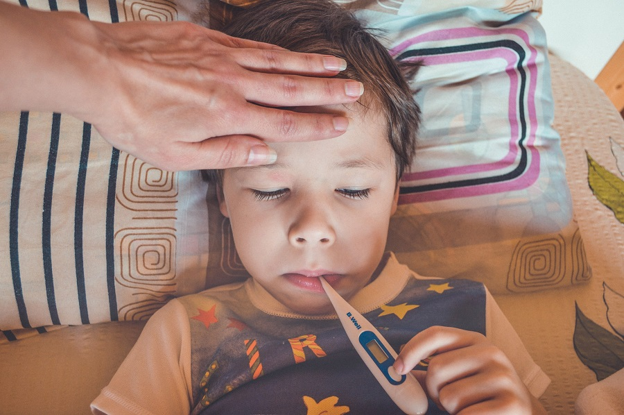 How to Break a Fever Naturally Parent Taking a Child's Temperature