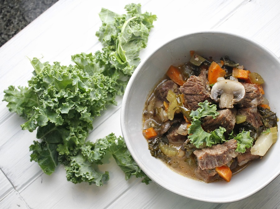 Whole30 Instant Pot Beef Stew Recipe Overhead View of a Bowl of Stew with Kale