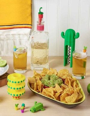 Avocado Chip and Dip Tray Filled with Chips Next to Party Supplies