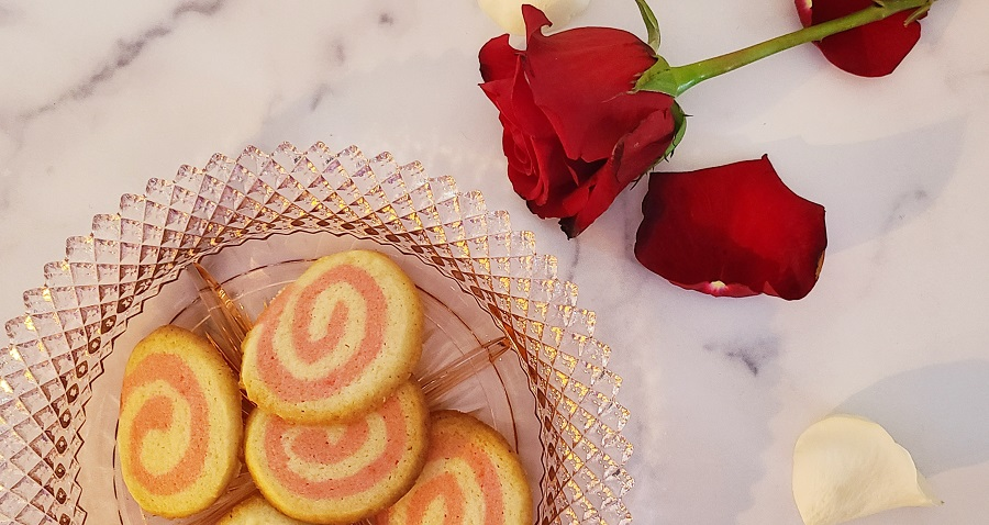 Pink Pinwheel Sugar Cookies on a Plate with Rose Petals Nearby