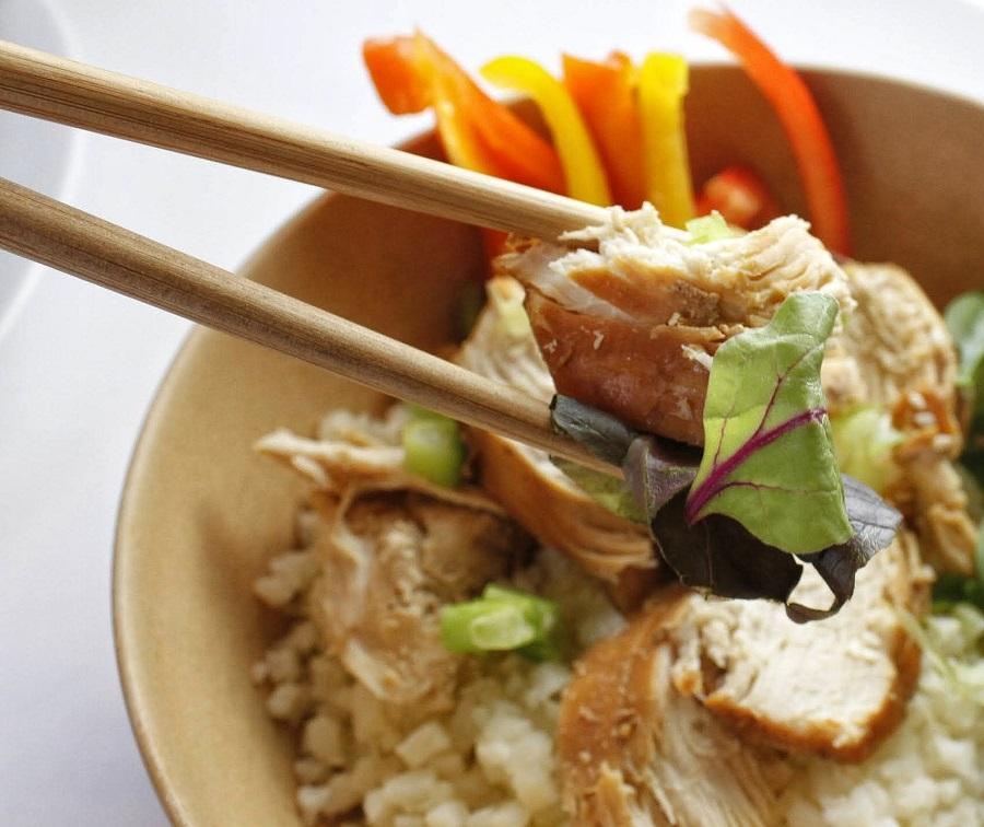 Whole30 Instant Pot Teriyaki Chicken Chopsticks Holding a Piece of Chicken