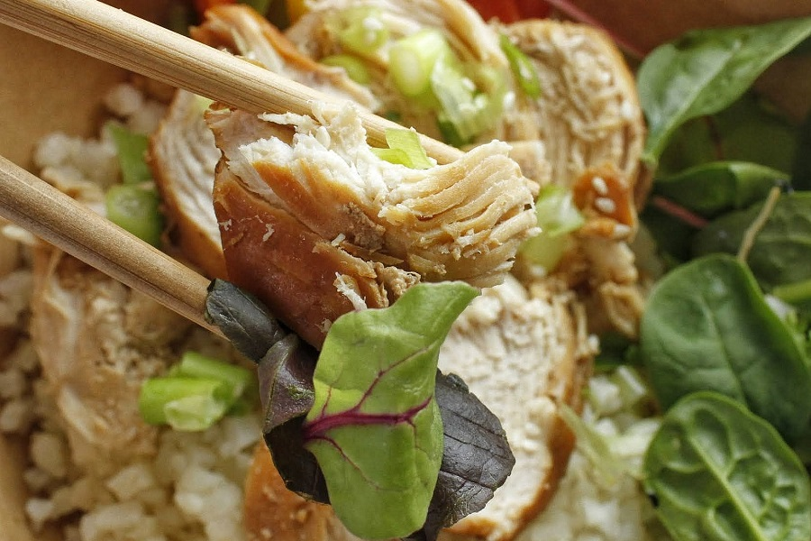 Whole30 Instant Pot Teriyaki Chicken Close Up of Chicken Being Held by Chopsticks