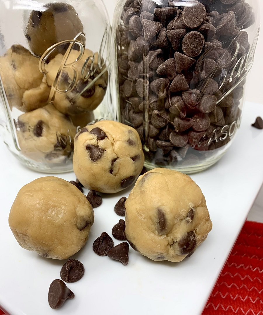 Edible Cookie Dough Bites Mason Jars with Bites Inside and Chocolate Chips Inside surrounded with Bites