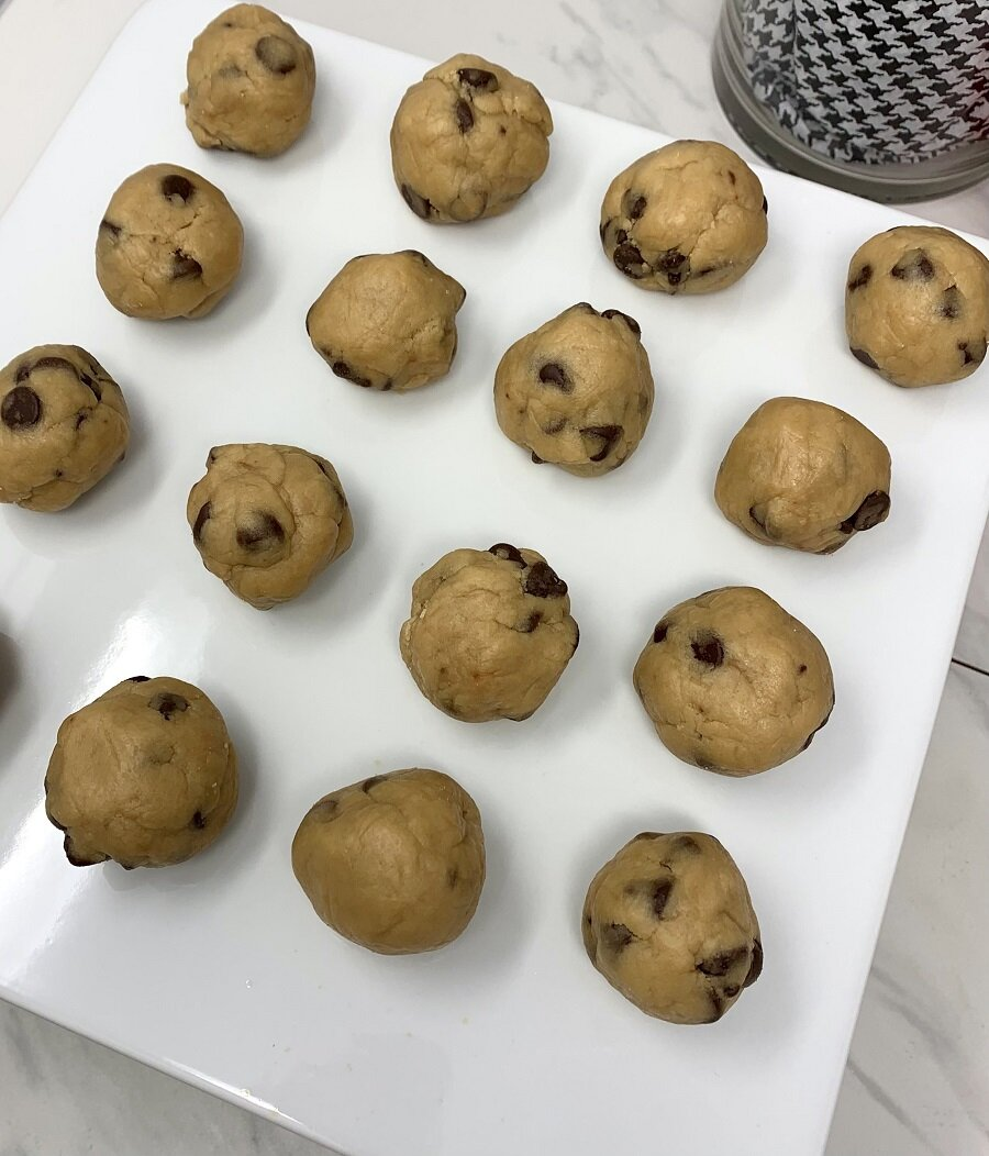 Edible Cookie Dough Bites in Rows on Parchment Paper