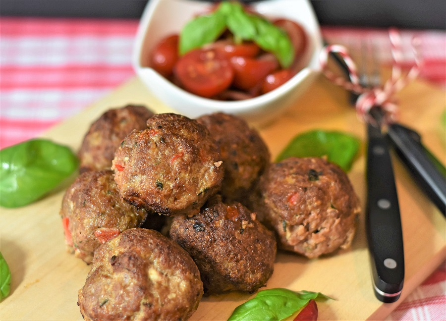 Instant Pot Party Meatballs Recipes Meatballs on a Cutting Board with Tomatoes in a Dish in the Background