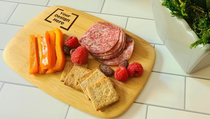 Personalized Mini Charcuterie Board Close Up of a Cheese Board with Meat, Crackers, Cheese, and Fruit