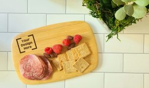 """Personalized Mini Charcuterie Board Overhead View of a Cheese Board with """"Your Design Here"""" in the Corner"""