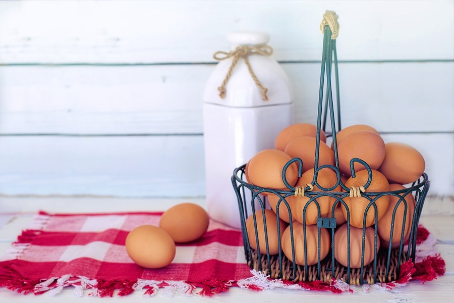 Breakfast Ideas for a Crowd A Basket of Bown Eggs with a Jug of Milk