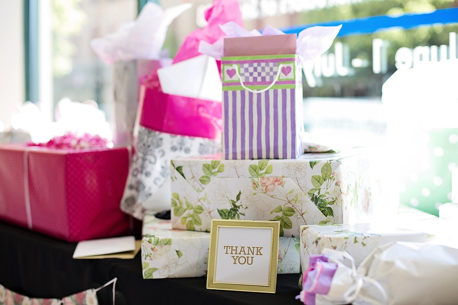 Entertaining Bridal Shower Games Gifts on a Table in Front of a Window