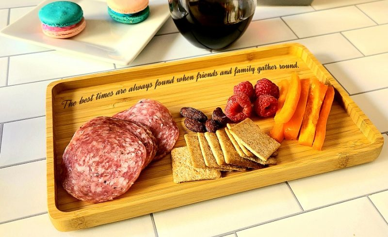 Angled View of Friendship Engraved Small Serving Tray with Meats and Cheeses on it