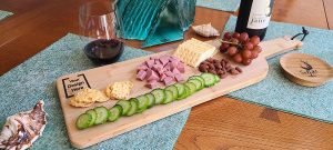 Overhead View of a Custom Engraved Wine Bottle Charcuterie Board