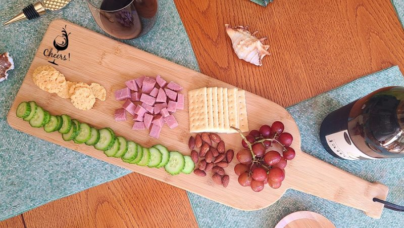 Engraved Wine Bottle Charcuterie Board Overhead View of The Cheers with Wine Bottles Design