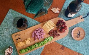Engraved Wine Bottle Charcuterie Board Overhead View of the Cheers with Glasses Design